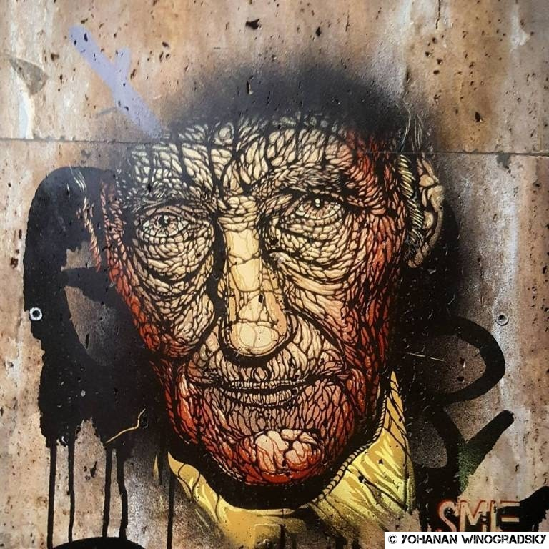 streetart paris par smile à la butte aux cailles, portrait de william s. burroughs