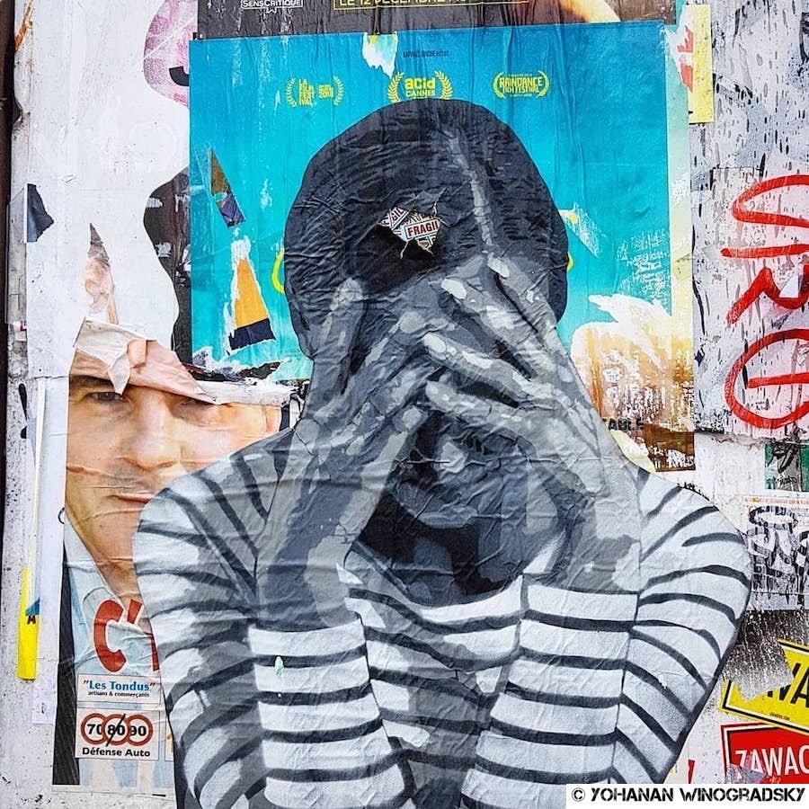 """street art paris par ender pour sa série """"fragile"""" rue beaubourg"""
