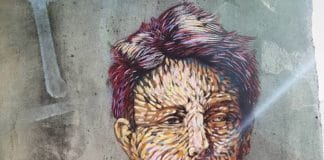 street art vitry sur seine pochoir de smile portrait d'arthur rimbaud
